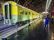 "05 DECEMBER 2013 - BANGKOK, THAILAND:  The King's personal train on display at Hua Lamphong Train Station on the 86th birthday of Bhumibol Adulyadej, the King of Thailand. Dec. 5, the King's Birthday, is a national holiday in Thailand, and is also celebrated as the country's ""Fathers' Day."" The State Railways of Thailand put on special trains to take people to the King's ""Summer Palace"" in the oceanside community of Hua Hin where the King granted a public audience. There were also merit making ceremonies throughout the country.  Many people wear yellow on the King's Birthday because yellow is the color associated with his reign. As of 2013, he was the longest reigning monarch in the world.          PHOTO BY JACK KURTZ"