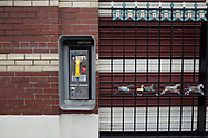 Coin operated pay phone at the carousel in Central Park.
