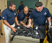 Technicians sort laptops for deployment to students at Kashmere High School, January 14, 2014.