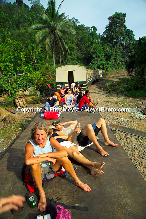 Padas River, Sabah, Borneo, Malaysia, March 2006. The grade 3 to 4 white water rafting river, Padas, is a cool adrenaline outing. To reach the launch point one must join the local population in a ramshackle train through the jungle.   Photo by Frits Meyst/Adventure4ever.com