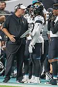 Aug 22, 2019; Miami Gardens, FL USA;  Jacksonville Jaguars head coach Doug Marrone talks with cornerback Tre Herndon (37)during an NFL preseason game at Hard Rock Stadium. The Dolphins beat the Jaguars 22-7. (Kim Hukari/Image of Sport)