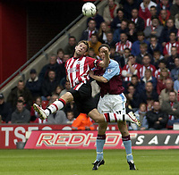 Picture: Henry Browne, Digitalsport<br /> NORWAY ONLY<br /> <br /> Date: 08/05/2004.<br /> Southampton v Aston Villa FA Barclaycard Premiership.<br /> <br /> James Beattie of Saints is pushed off the ball by Villa's Ronny Johnsen.