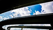 A long haul tractor trailer on an elevated highway ramp outside Tampa.
