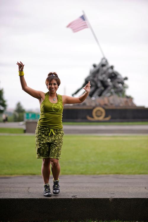(photo by Matt Roth).Monday, June 18, 2012..Retired Marine & Zumba Instructor Liz Medina dances at The Marine Corps War Memorial/Iwo Jima Memorial in Arlington, Virginia Monday, June 18, 2012..