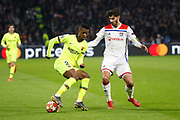 Nelson Semedo of Barcelona and Terrier Martin of Lyon during the UEFA Champions League, round of 16, 1st leg football match between Olympique Lyonnais and FC Barcelona on February 19, 2019 at Groupama stadium in Decines-Charpieu near Lyon, France - Photo Romain Biard / Isports / ProSportsImages / DPPI