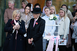 © Licensed to London News Pictures . 30/10/2018. Accrington , UK . Gemma's mother HELEN SPROATES holds one of two white doves outside the crematorium after the service . The funeral of Gemma Nuttall at Accrington Crematorium . Gemma died of cancer despite initially seeing off the disease after radical immunotherapy treatment in Germany , paid for with the fundraising support of actress Kate Winslet , who read of Gemma's plight on a crowdfunding website shortly after she lost her own mother to cancer . Permission to photograph given by Gemma's mother , Helen Sproates . Photo credit : Joel Goodman/LNP