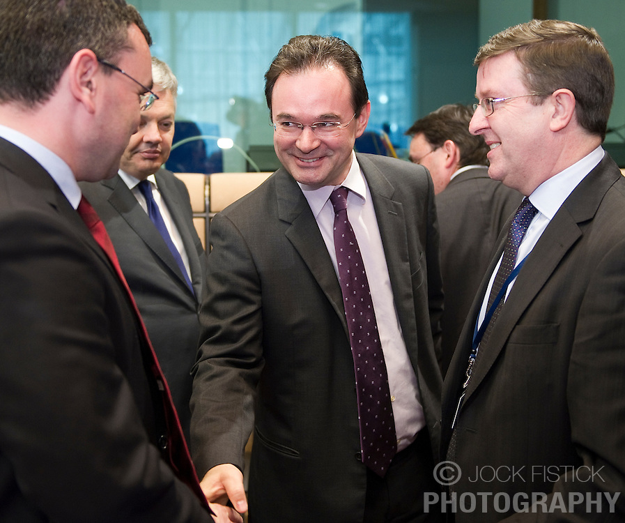 George Papaconstantinou, Greece's finance minister, center, greets colleagues during the meeting of European Union finance ministers in Brussels, Belgium, on Monday, May 17, 2010.  (Photo © Jock Fistick)