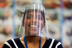 © Licensed to London News Pictures. 06/05/2020. London, UK. A member of staff at Gladesmore Community School in Tottenham, north London wears a face shield, which the school has been making for NHS staff and front line key workers, using technology equipment and a laser cutter. Over a thousand face screens have been delivered to local care homes in Tottenham and to Newham University Hospital. There is a shortage of PPE during the COVID-19 pandemic, many schools and clothing manufacturers producing equipment for the NHS and front line key workers. Photo credit: Dinendra Haria/LNP