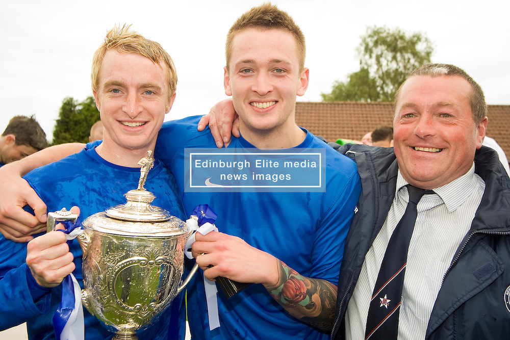 Pictured: Centre Shaun Woodburn in happier times winning east of scotland cup with newtongrange in 2011<br /> Former Bonnyrigg Rose player Shaun Woodburn was taken to the ERI in a critical condition following a disturbance in Great Junction Street, Leith, at around 2am. . Police confirmed at 10.45pm that a 30-year-old had died and the death is being treated as murder.<br /> Andrew West | EEm 1 January 2017