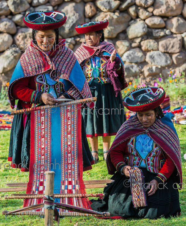 Cuzco, Peru - July 15, 2013: women weaving in the peruvian Andes at Cuzco Peru on july 15th, 2013