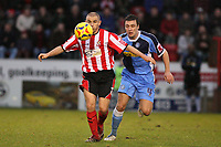 Photo: Pete Lorence.<br />Lincoln City v Wycombe Wanderers. Coca Cola League 2. 30/12/2006.<br />Lincoln City star, Jamie Forrester, shields the ball from Russell Martin.