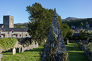 A pyramid memorial in the cemetery of St. Mary's Church and in the distance, the 2,928ft mountain Cader Idris, on 12th September 2018, in Dolgellau, Gwynedd, Wales.