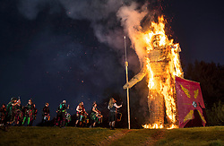 © Licensed to London News Pictures. 05/05/2018. Chalton, UK. The 'Pentacle Drummers' perform as a 30 foot high Wickerman is burnt at The Beltain Festival at Butser Ancient Farm in Hampshire. Over two thousand people gathered to witness the ancient Beltain Celtic celebration of summer - which will culminates in the burning of the giant Wickerman.  Photo credit: Peter Macdiarmid/LNP