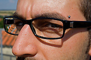 close up of man's eyes and glasses