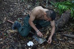 El Diamante, Meta, Colombia - 15.09.2016        <br /> <br /> A guerilla fighter edge a spade to construct new latrines. Guerilla camp during the 10th conference of the marxist FARC-EP in El Diamante, a Guerilla controlled area in the Colombian district Meta. Few days ahead of the peace contract passing after 52 years of war with the Colombian Governement wants the FARC decide on the 7-days long conferce their transformation into a unarmed political organization. <br /> <br /> Ein Guerilla Kaempfer schaerft einen Spaten um Latrinen auszuheben. Guerilla-Camps zur zehnten Konferenz der marxistischen FARC-EP in El Diamante, einem von der Guerilla kontrollierten Gebiet im kolumbianischen Region Meta. Wenige Tage vor der geplanten Verabschiedung eines Friedensvertrags nach 52 Jahren Krieg mit der kolumbianischen Regierung will die FARC auf ihrer sieben taegigen Konferenz die Umwandlung in eine unbewaffneten politischen Organisation beschlieflen. <br />  <br /> Photo: Bjoern Kietzmann