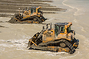 The Army Corps of Engineers use heavy machinery to restore the beach during a major beach replenishment project May 12, 2014 in Folly Beach, SC.