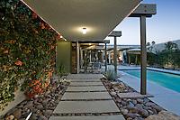 Back yard with swimming pool alongside modern house