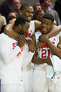DALLAS, TX - FEBRUARY 19: Yanick Moreira #2 of the SMU Mustangs (center) hugs Jean-Micheal Mudiay #24 and Ben Emelogu #21 during the closing minutes against the Temple Owls on February 19, 2015 at Moody Coliseum in Dallas, Texas.  (Photo by Cooper Neill/Getty Images) *** Local Caption *** Yanick Moreira; Jean-Micheal Mudiay; Ben Emelogu