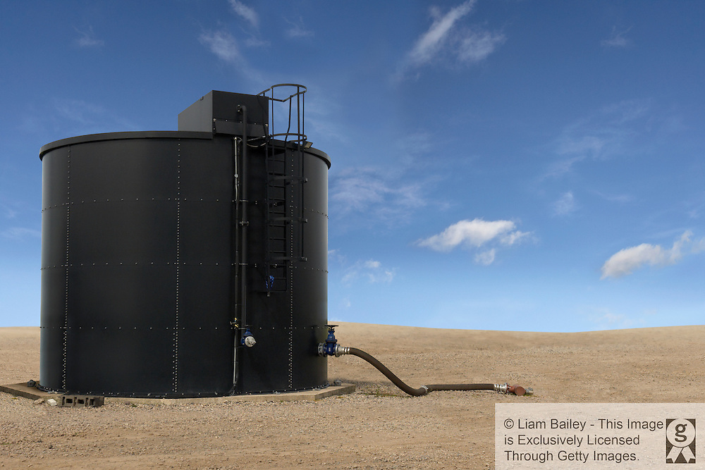 Single large oil tank. Blue sky, Oil pipe