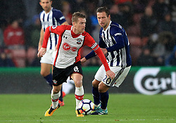 Southampton's Steven Davis (left) and West Bromwich Albion's Grzegorz Krychowiak (right) battle for the ball during the Premier League match at St Mary's Stadium, Southampton.