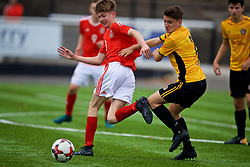 MERTHYR TYDFIL, WALES - Thursday, November 2, 2017: Wales' Charlie Williams and Newport County's Ryan Scrivens during an Under-18 Academy Representative Friendly match between Wales and Newport County at Penydarren Park. (Pic by David Rawcliffe/Propaganda)