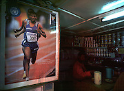Local hero and multi-world record holder Haile Gebreselassie in a poster in a drinks shop in downtown Addis.