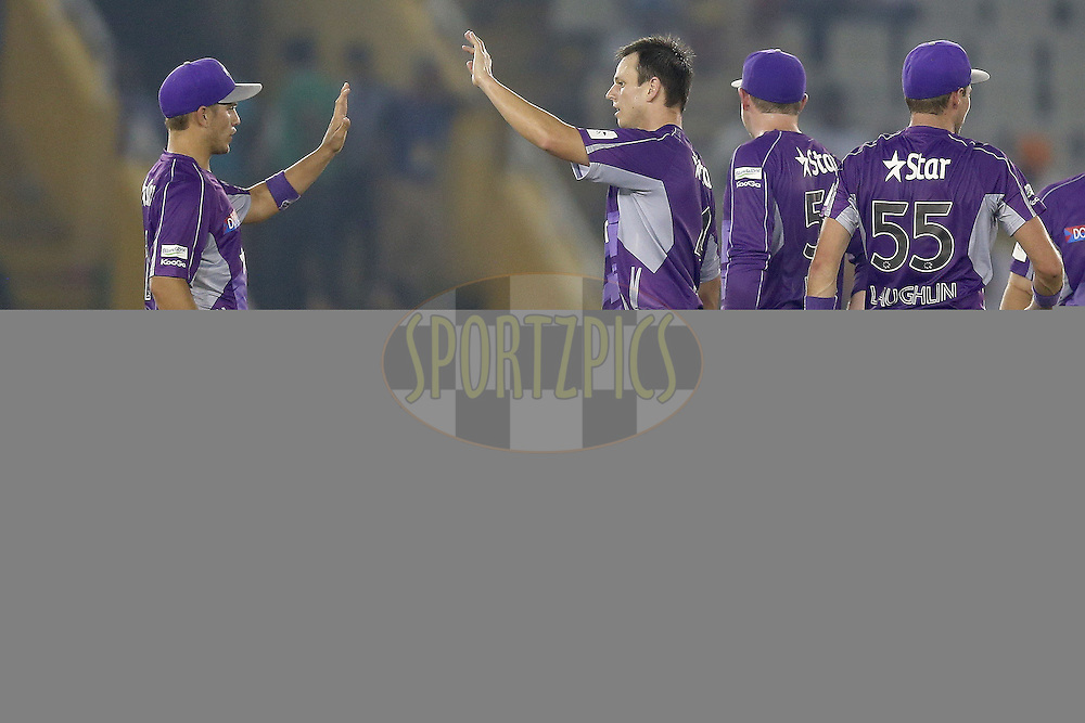 Ben Laughlin is congratulated by his teammates after taking the wicket of Glen Maxwell during match 2 of the Oppo Champions League Twenty20 between the Kings XI Punjab and the Hobart Hurricanes held at the Punjab Cricket Association Stadium, Mohali, India on the 18th September 2014. Photo by:  Jacques Rossouw / Sportzpics/ CLT20<br /> <br /> <br /> Image use is subject to the terms and conditions as laid out by the BCCI/ CLT20.  The terms and conditions can be downloaded here:<br /> <br /> http://sportzpics.photoshelter.com/gallery/CLT20-Image-Terms-and-Conditions-2014/G0000IfNJn535VPU/C0000QhhKadWcjYs