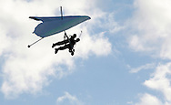 Hang glider pilot Thomas Atkins and a passenger fly above Randall Airport in Middletown, N.Y., on Friday, Aug. 23, 2013. The hang glider rides are offered by Hangar 3. (AP Photo/Times Herald-Record/TOM BUSHEY)
