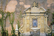 Shrine on the Basilica wall at Mission San Carlos Borromeo de Carmelo, Carmel, California USA