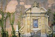Shrine on the Basilica wall at Mission San Carlos Borromeo de Carmelo, Carmel, California USA
