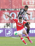 Portugal, FUNCHAL : Nacional´s Brazilian midfielder Diego  (L )  vies with Benfica's Uruguayan midfielder Urreta(r) during Portuguese League football match Nacional vs Benfica at Madeira Stadium in Funchal on February 10, 2013.PHOTO/ GREGORIO CUNHA..