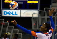Florida's Rhamat Alhassan prepares to serve against St. John's Thursday night at the O'Dome. (photo by Samuel Navarro)