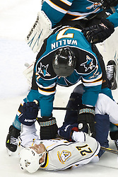 January 8, 2011; San Jose, CA, USA; San Jose Sharks defenseman Niclas Wallin (7) knocks Nashville Predators right wing Patric Hornqvist (27) to the ice during the first period at HP Pavilion. Mandatory Credit: Jason O. Watson / US PRESSWIRE