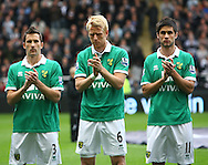 Picture by Paul Chesterton/Focus Images Ltd.  07904 640267.18/03/12.The Norwich players observe a minutes applause for Bolton's Fabrice Muamba before the Barclays Premier League match at St James' Park Stadium, Newcastle.