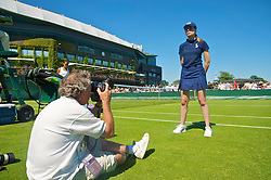 LONDON, ENGLAND - Tuesday, June 23, 2009: Photographer Tommy Hindley takes a photograph of a ball girl during the Ladies' Singles 1st Round match on day two of the Wimbledon Lawn Tennis Championships at the All England Lawn Tennis and Croquet Club. (Pic by David Rawcliffe/Propaganda)