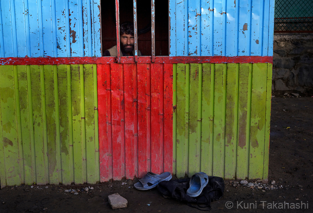 (Kabul Afghanistan - May 17, 2012).A man sits at the ticket booth of amusement park in Kabul, Afghanistan. With an estimated population of 30 million, the war-torn country has been struggling to rebuild while political instability continues. .(Photo by Kuni Takahashi)