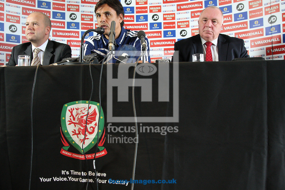 Picture by Mark Hawkins/Focus Images Ltd 07949 023795<br /> 15/11/2013<br /> FAW Chief Executive Jonathan Ford (left), Wales National Team Manager Chris Coleman (centre), and President of the FAW Trevor Lloyd Hughes (right), pictured during the FAW press conference at St David's Hotel, Cardiff.
