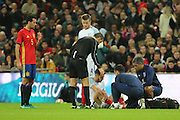 England attacker Adam Lallana (11) receiving treatment for injury during the Friendly match between England and Spain at Wembley Stadium, London, England on 15 November 2016. Photo by Matthew Redman.
