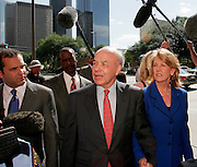 Former Enron chairman Kenneth Lay (L) leaves the Bob Casey U.S. Courthouse with his wife, Linda, following proceedings in his fraud and conspiracy trial, May 16, 2006, in Houston. The defense presented it's closing arguments in the trial that has spanned 16 weeks. (Photo by Dave Einsel)