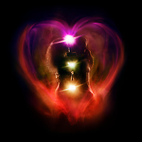 Tantra and Tantric sexuality artistic spiritual concept of a couple making love with the colorful chakra energy flow glowing emanations in a shape of a heart around their bodies. Isolated on black background.