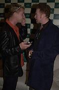 Eddie Irvine and Mick Hucknall. Jaguar party. Casa Batllo, Barcelona. 27 April 2001. © Copyright Photograph by Dafydd Jones 66 Stockwell Park Rd. London SW9 0DA Tel 020 7733 0108 www.dafjones.com