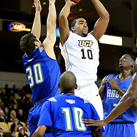 Dwight McCombs (10)  of the University of Central Florida Knights mens basketball team drives the ball against West Florida Argonauts players Mike Whisman (30) and Mike Lewis (10) in the first home game of the 2010 season at the UCF Arena on November 12, 2010 in Orlando, Florida. UCF won the game 115-61. (AP Photo/Alex Menendez)