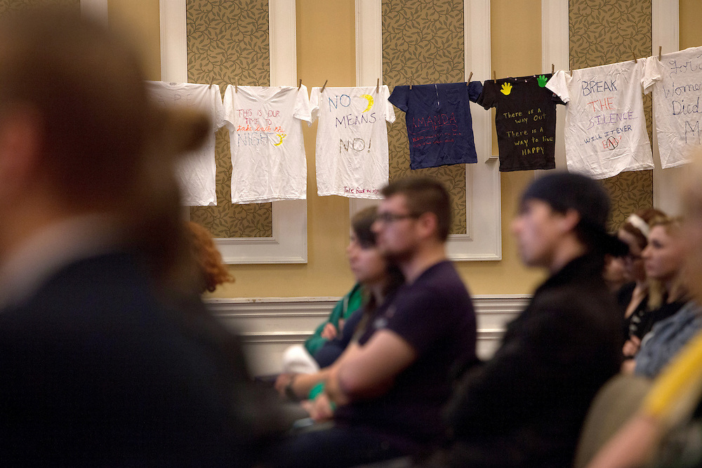 T-shirts hand-decorated with messages of female empowerment hang in Baker Center Ballroom during the Take Back the Night event on April 3, 2014. Photo by Lauren Pond / Ohio University