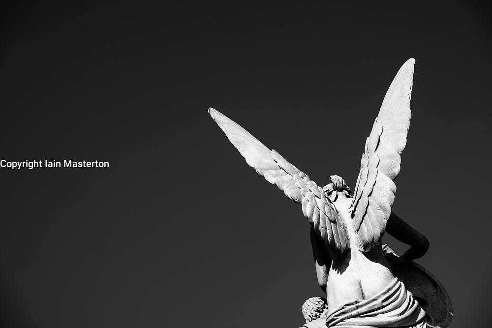 Statue of angel on Schlossbrucke designed by Schinkel at Lustgarten on Museum Island (Museumsinsel) in Mitte, Berlin, Germany