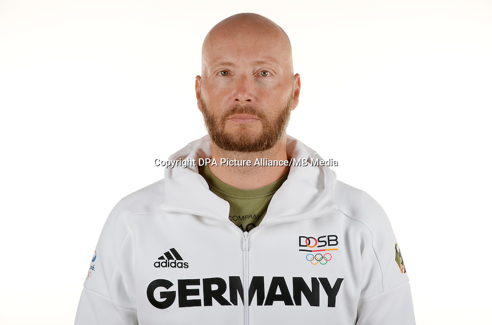 Alexander Schmidt poses at a photocall during the preparations for the Olympic Games in Rio at the Emmich Cambrai Barracks in Hanover, Germany. July 08, 2016. Photo credit: Frank May/ picture alliance. | usage worldwide