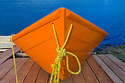 Orange boat on dock<br /> Frenchman Cove<br /> Newfoundland <br /> Canada