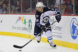 Jan 17; Newark, NJ, USA; Winnipeg Jets right wing Tim Stapleton (14) skates with the puck during the second period at the Prudential Center.