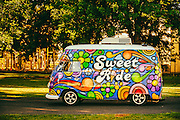 A vendor arrived at Proprietors Park in Gloucester City for the first Summer Concert Series of the year. The early model VW bus being used, and its paint scheme, were definitely an eye catcher I believe it was water ice that was for sale.