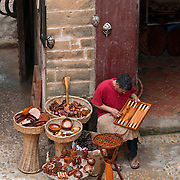 Artisan outside his shop in Essaouira, Morocco