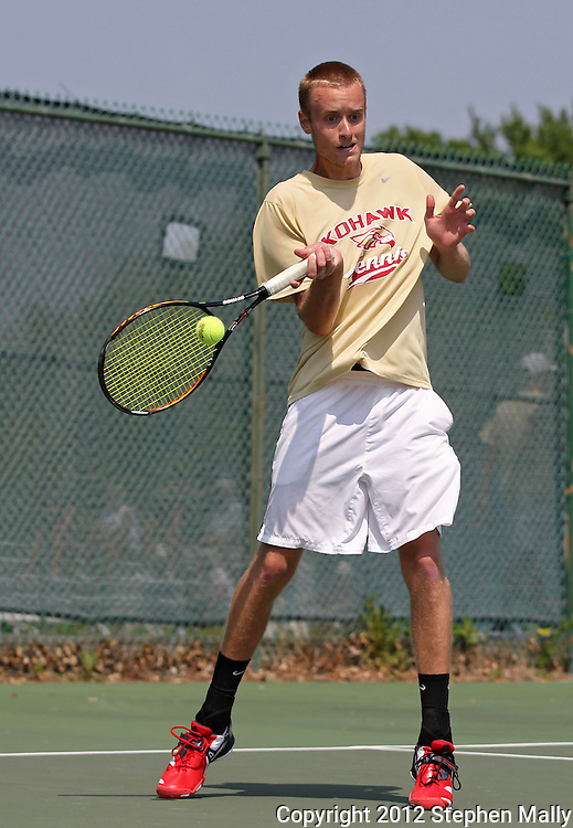 Coe's Jeff Damisch returns the ball during his match against Luther's Aaron Gendron in the Iowa Conference Men's Tennis Championships at Veterans Memorial Tennis Center in Cedar Rapids on Saturday afternoon, May 5, 2012. (Stephen Mally/Freelance)
